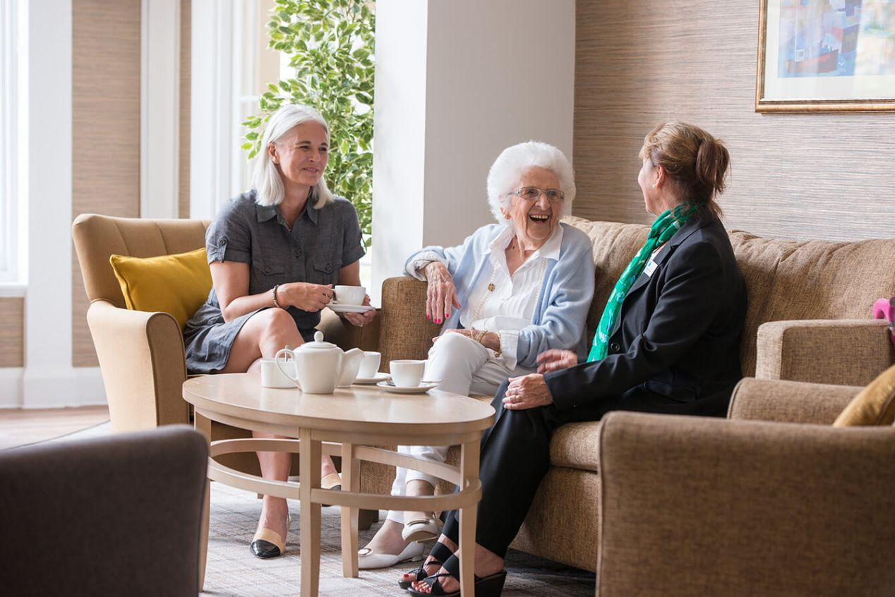 Seniors-customer-journey-home-manager-chatting-with-resident-and-daughter.jpg